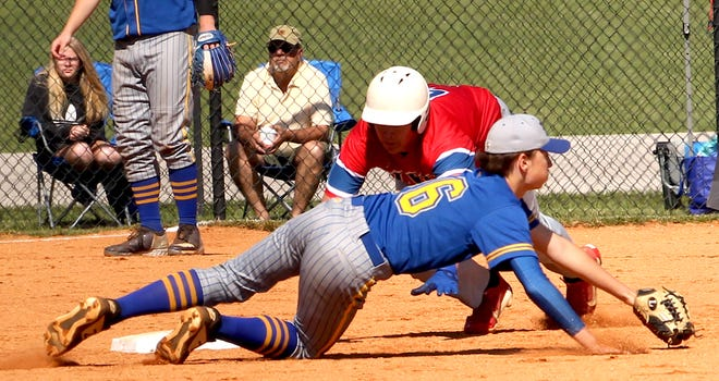 Mitchell's Kody Earl attempts to get the out at second on Linton's Nathan Frady during the sectional semifinal at Mitchell on Monday.