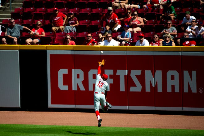 Max Schrock's fifth-inning triple soars over the head of Phillies right fielder Brad Miller.