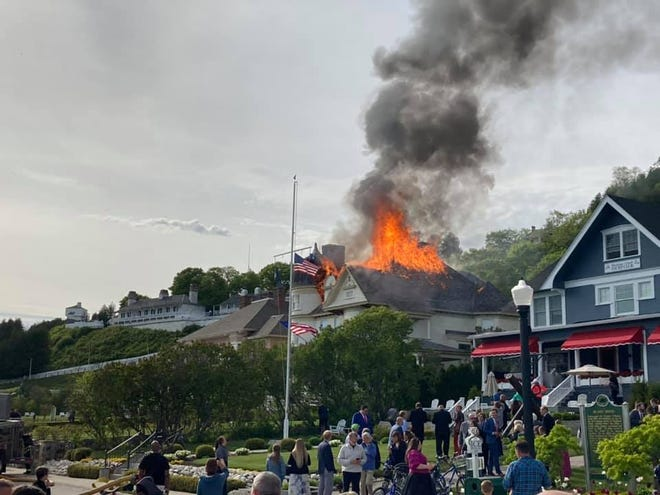 The Brigadoon cottage on Mackinac Island is shown on fire May 30, 2021.