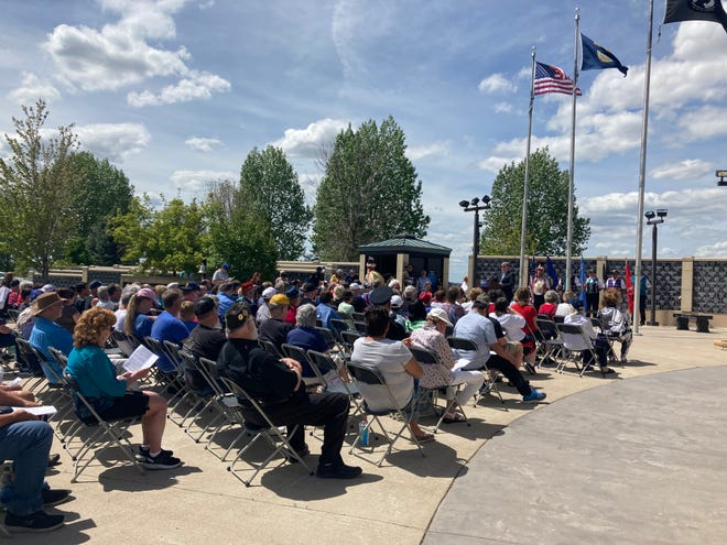 About 200 people turned out for the Memorial Day ceremony at the Montana Veterans Memorial in Great Falls Monday. Maj. Gen. John P. Hronek, Commander of the Montana National Guard, was the keynote speaker. Chief Earl Old Person, Professor Marvin Weatherwax and Timothy F. Davis of the Blackfeet Tribal Business Council also spoke.