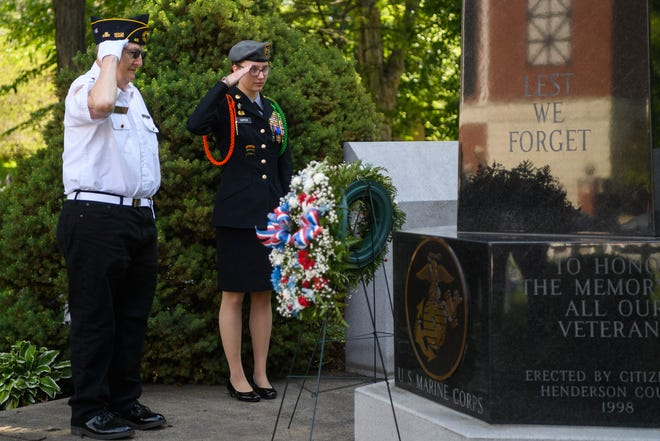 Paul Berberich of the Henderson American Legion Post 40 Honor Guard and 1st Sgt. Samantha Hopper of the Henderson County High School Junior ROTC give a salute after placing a wreath to honor all United States Air Force veterans during the annual Memorial Day service at Central Park in Henderson, Ky., Monday, May 31, 2021.