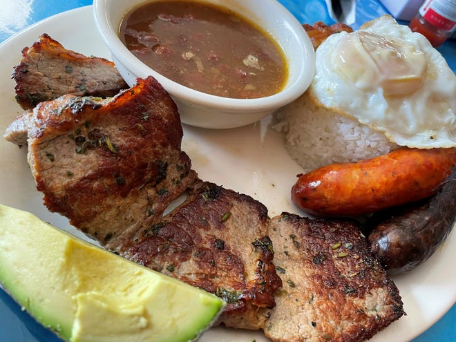 Among the items featured in the bandeja paisa completaat Delicias Colombianas  are grilled steak, Colombian sausage, fried egg, rice and beans.