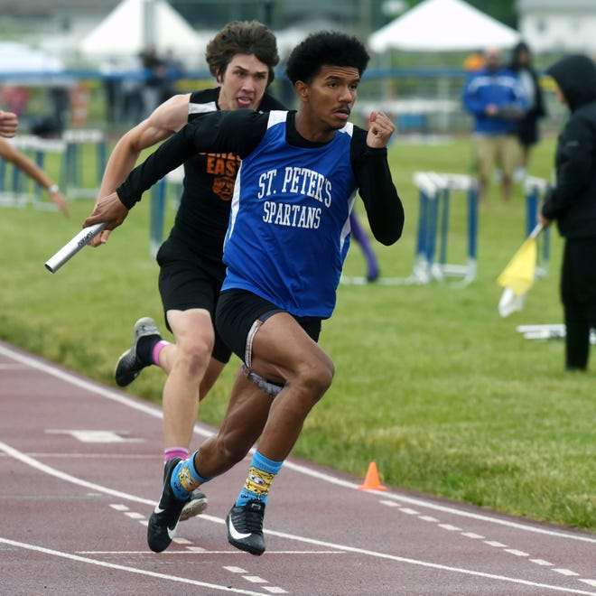 Mansfield St. Peter's Donovan Duncan runs the 4x200 relay during the Division III regional track and field meet on May 28 at Chillicothe Southeastern.