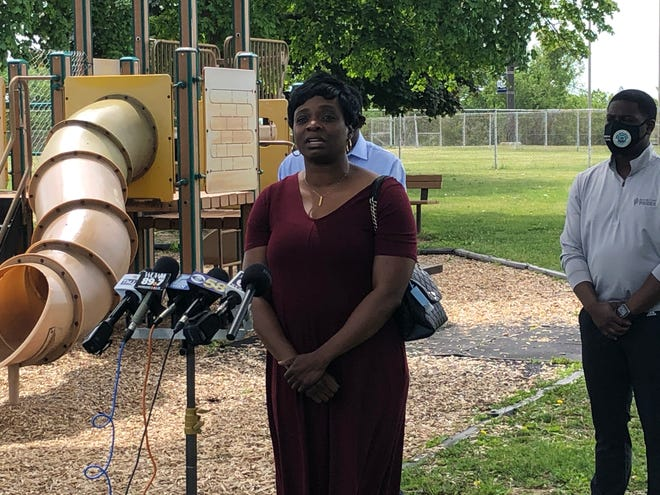 Chytania Brown, president and CEO of Employ Milwaukee, speaks at a press conference Monday on getting young people summer jobs.
