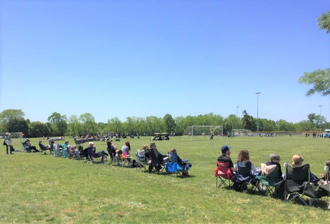 Spectators line a pitch at Canton's Heritage Park May 30.