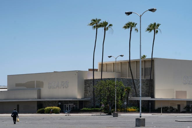 This Thursday, May 27, 2021, photo shows the closed Sears in Buena Park Mall in Buena Park, Calif. California state lawmakers are grappling with a particularly 21st-century problem: What to do with the growing number of shopping malls and big-box retail stores left empty by consumers shifting their purchases to the web. A possible answer in crowded California cities is to build housing on these sites, which already have ample parking and are close to existing neighborhoods.