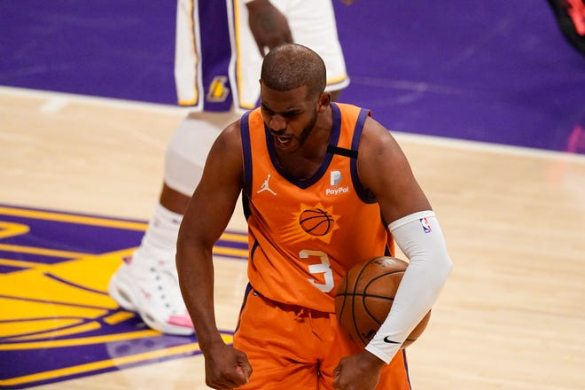 Phoenix Suns guard Chris Paul celebrates after forcing a turnover during the second half in Game 4 of an NBA basketball first-round playoff series against the Los Angeles Lakers Sunday, May 30, 2021, in Los Angeles.