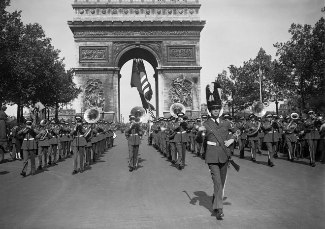 A platoon of British soldiers marches on May 8, 1945, along the Avenue des Champs-Elysees during a parade in Paris celebrating The Allies' Victory Over Nazi Germany and the third anniversary of American women in service. (AFP via Getty Images)