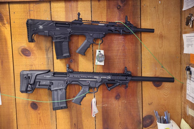 Rifles are offered for sale at Freddie Bear Sports on April 8, 2021 in Tinley Park, Illinois. (Scott Olson/Getty Images/TNS)
