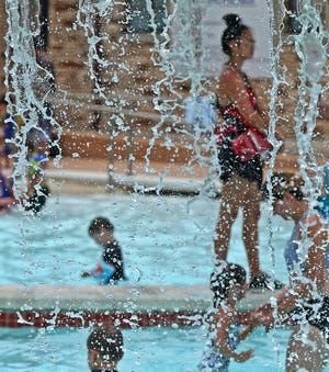 People take advantage of the reopening of the municipal pool during the Memorial Day weekend on Sunday, May 30, 2021.