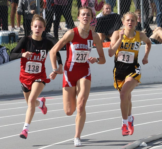 Madala Hanson (left) tracks down No. 1 seeded Emma Thomas from Gregory in the 1600 meter run at the Class B State Track and Field meet in Rapid City on Friday, May 29, 2021.
