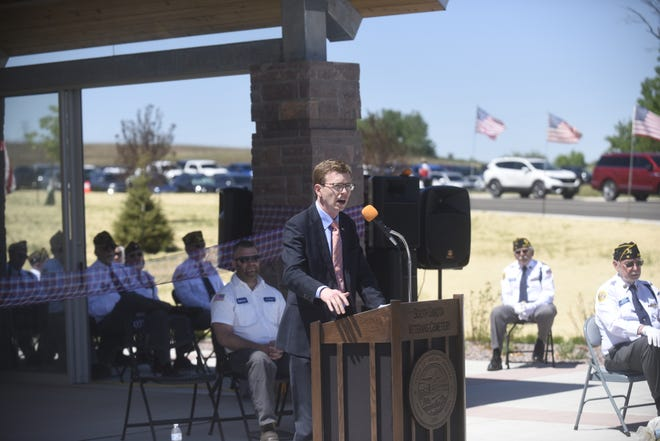 Rep. Dusty Johnson speaks at a Memorial Day service at the South Dakota Veterans Cemetery.
