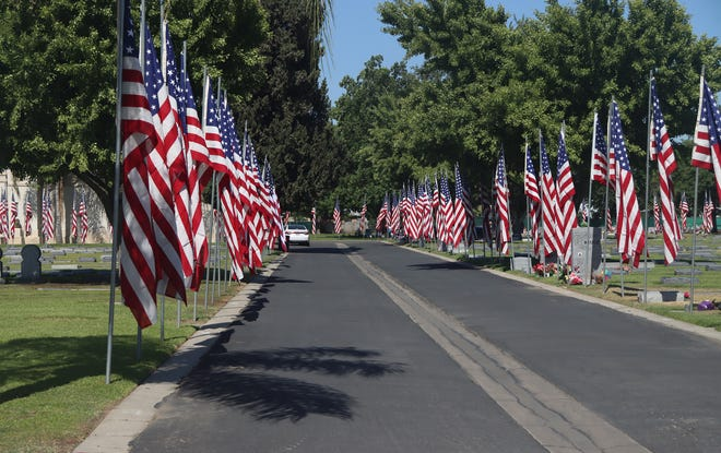 Thousands of flags line the walkways of Visalia Cemetery on Memorial Day.