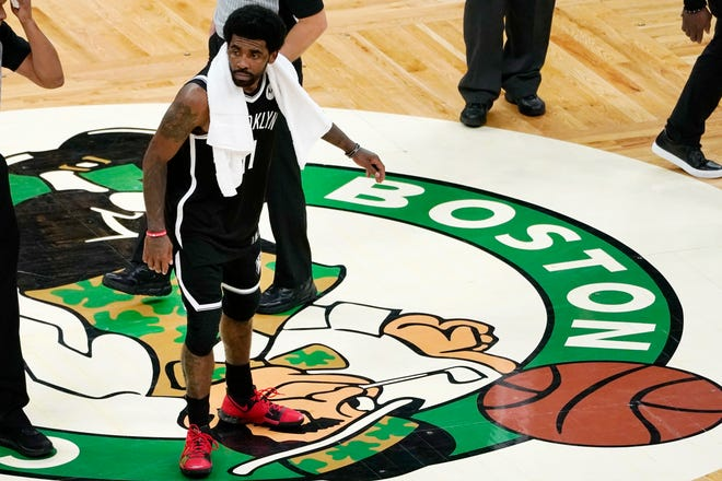 Nets guard Kyrie Irving scraped his foot on the Celtics' logo at midcourt on Sunday.