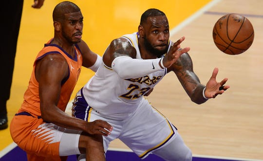 LeBron James got the ball as the Suns' Chris Paul guarded during Game 4 of the playoff series at the Staples Center.