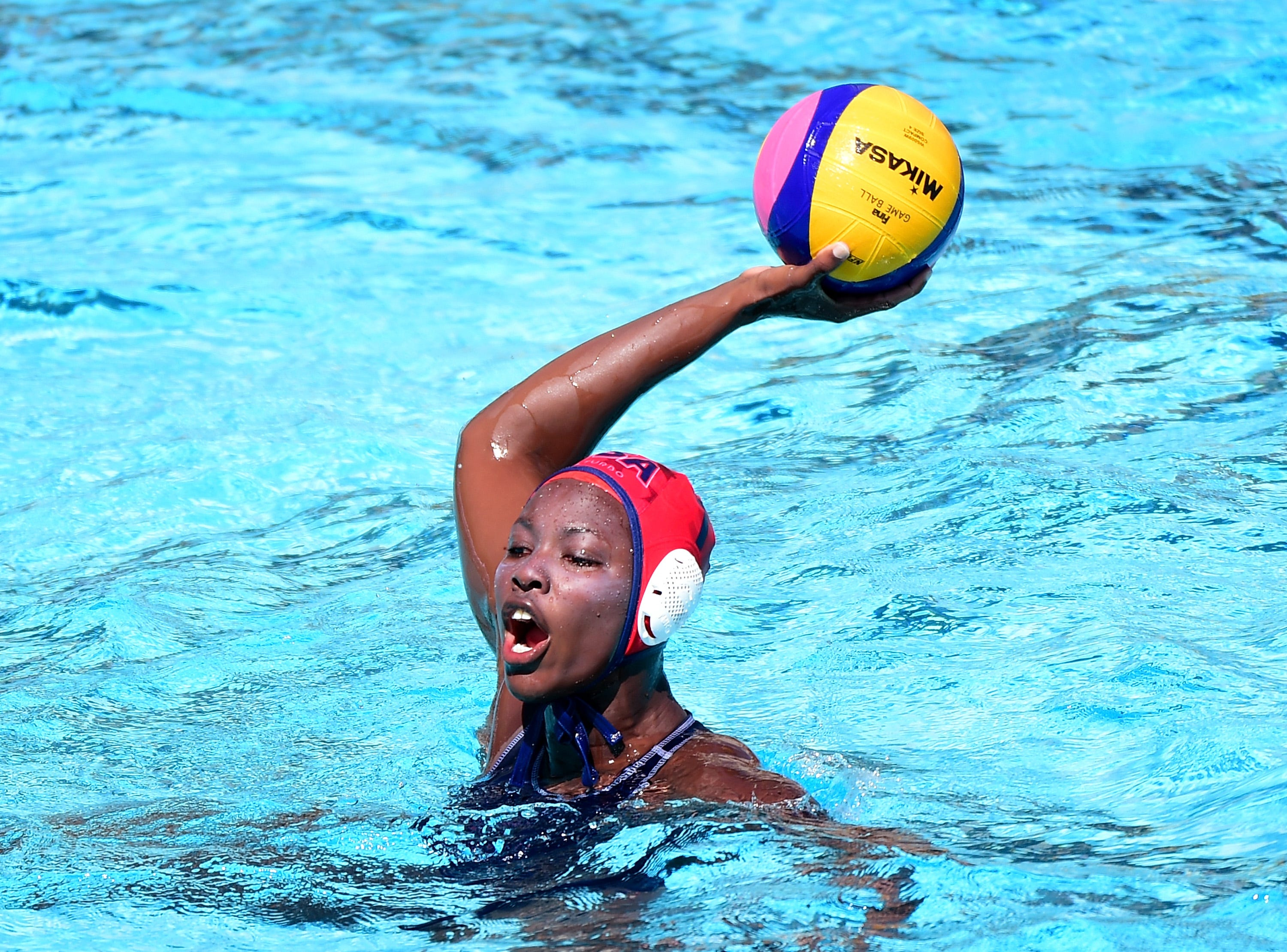 U.S. water polo star Ashleigh Johnson embraces role outside the pool