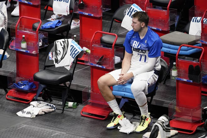 Luka Doncic sits on the bench in the fourth quarter of the Mavericks' loss to the Los Angeles Clippers in Game 4 of a first-round playoff series. After winning two games in L.A. to start the series, Dallas dropped both games at home.