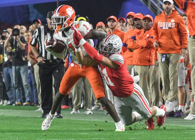 Clemson sophomore Derion Kendrick nearly intercepts. A ball near Ohio State wide receiver Austin Mack(11) during the third quarter of the PlayStation Fiesta Bowl of the College Football Playoffs semi-final game, at State Farm Stadium in Glendale, Arizona Saturday, December 28, 2019.  Clemson Vs Ohio State Fiesta Bowl