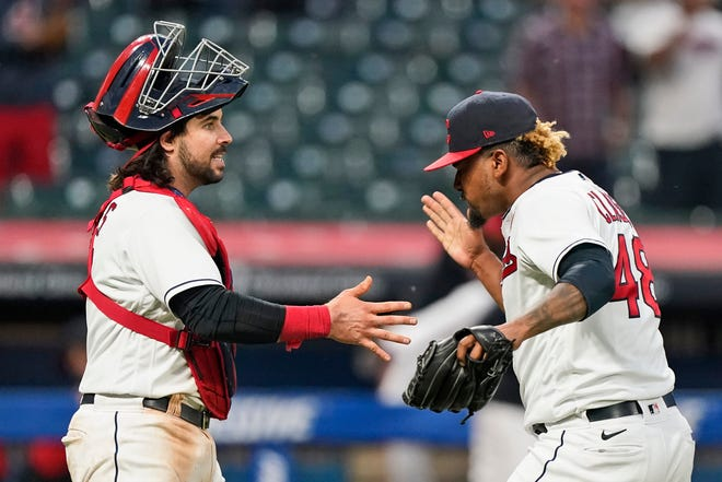 Cleveland relief pitcher Emmanuel Clase, right, is congratulated by catcher Austin Hedges after the Indians defeated the Chicago White Sox 3-1 in the second baseball game of a doubleheader, Monday, May 31, 2021, in Cleveland. (AP Photo/Tony Dejak)