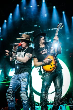 Axl Rose performs with Slash at a Guns N' Roses concert July 24, 2018, in Reykjavik, Iceland.