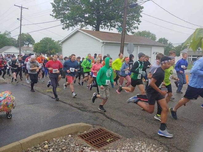 Runners compete in the sixth annual DFC Celebrate Recovery 5K and Duathlon on May 29. More than 220 people participated.