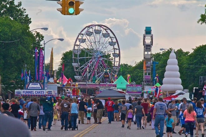 A crowd enjoys the carnival at Love County Frontier Days.