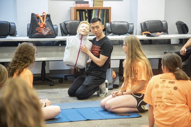 Students watch a demonstration during Operation Orange at Southeastern Oklahoma State University. The university in Durant will host the one-day camp next week for high school students interested in a health care career.