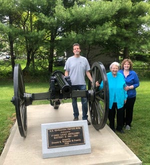 The Williams family with the memorial cannon dedicated to Donald Williams, are, from left, Wayne Williams, Dorlene Williams and Teresa Williams Drushel.