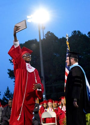 Screven County High School Class of 2021 graduate Jonathan Boyd raises his diploma up high so the hundreds in attendance at Kelly Memorial Stadium May 28 for the ceremony can see.