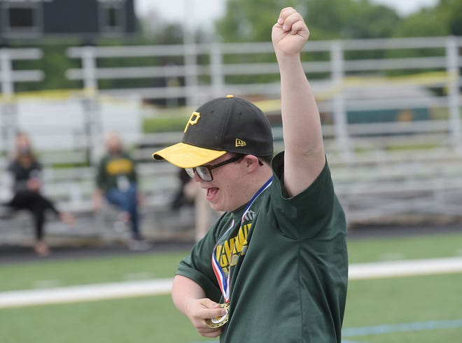 Ninth-grader Jack Masterson reacts to receiving his medal on Tuesday morning during Blackhawk School District's Special Olympics at Blackhawk High School. Approximately 30 students in grades K-12 participated in the event.