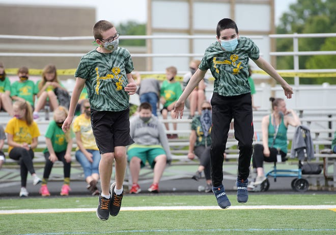 Middle -schoolers Wyatt Genzler, left, and Dante Durso participate in the long jump Tuesday morning during Blackhawk School District's Special Olympics at  Blackhawk High School. Approximately 30 students in grades K-12 participated in the event.