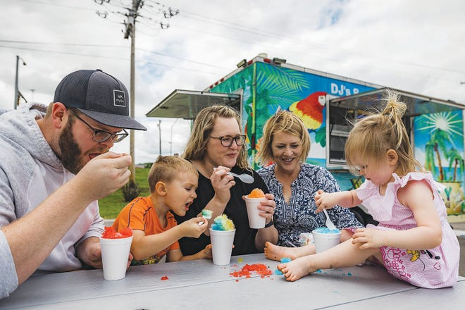The Lively family enjoys an afternoon treat of shaved ice from DJ's Southern Snow in the Eastland Parking lot on Tuesday afternoon in Bartlesville.