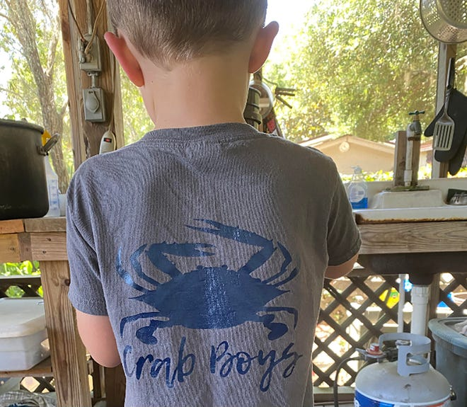 Summer means crabbing season. Logan Tanner is ready to catch 'em with a personalized shirt made by his mom Jessica.