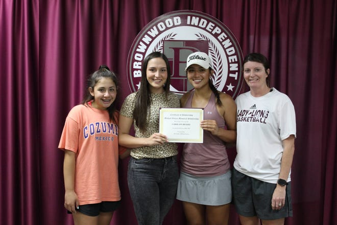 The recipient of this year's 2021 Mike Garcia Lady Lion Basketball Scholarship is CarolAnn Hetzel. Lady Lion Head Basketball Coach Heather Hohertz-Perez joined Mallory Garcia and Tristyn Garcia as Hetzel was presented the scholarship certificate on May 27.