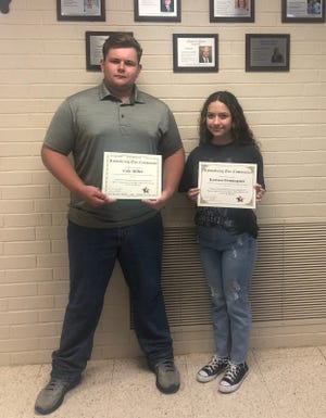 Revitalizing Our Community (ROC) awarded scholarships last month to Early High School seniors Cole Miller and Karissa Dominguez.