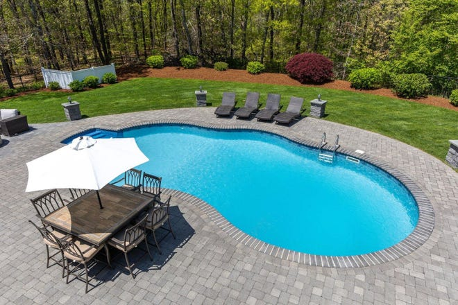 The backyard also has an easy-to-maintain saltwater pool.  [SOTHEBY INTERNATIONAL REALTY]
