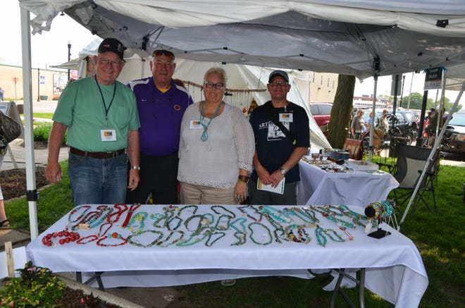 Pictured from the left are John Webb, Canton Mayor Kent McDowell, Susan Webb and Eric Duffield during 2019 Art on Main. After being canceled in 2020 due to COVID-19 it is going to be held this year June 5 and 6.