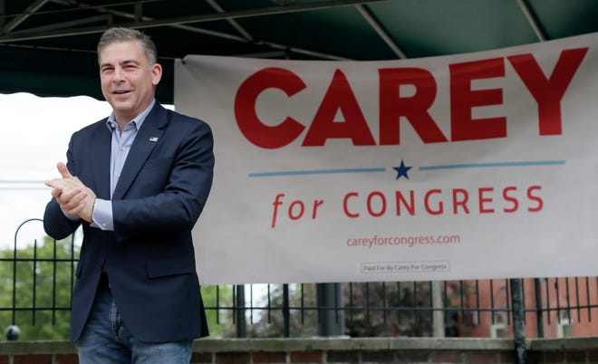 Mike Carey, a 15th Congressional District special election candidate, speaks to a small crowd at the kick-off of a tour across Ohio's 15th Congressional District to speak with voters and promote Carey's candidacy in Grove City, Ohio, on Tuesday, June 1, 2021.