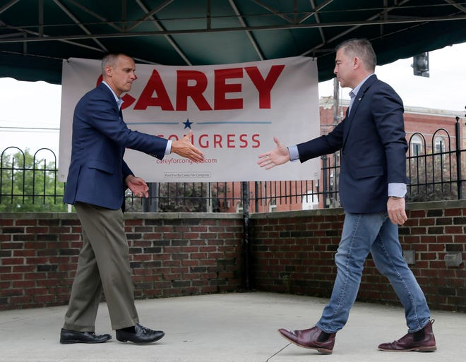 Former Trump aide Corey Lewandowski, left, introduces Mike Carey, a 15th Congressional District special election candidate, during a tour across Ohio's 15th Congressional District to speak with voters and promote Carey's candidacy in Grove City, Ohio, on Tuesday, June 1, 2021.