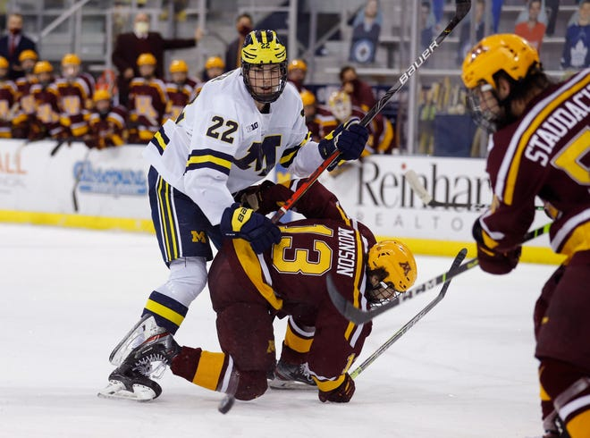 Michigan defenseman Owen Power, left, is considered one of the top players in this year's NHL draft.