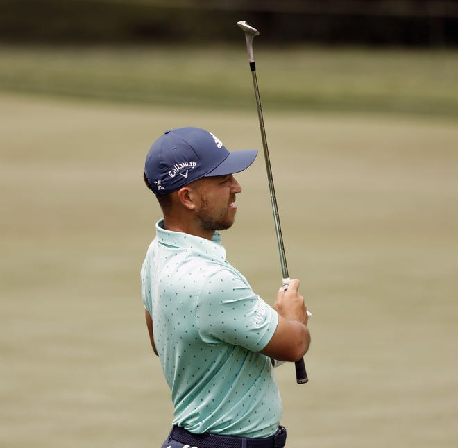 """Xander Schauffele watches his chip on the first green during practice on Tuesday at Muirfield Village Golf Club. Schauffele says his missed cut at the PGA Championship was """"a good time to sort of reboot and kind of recheck where I'm at."""""""