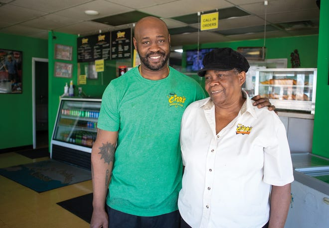 Ena Hayles with her son, Marlon Hayles, at their family restaurant Ena's Caribbean Kitchen in the Linden neighborhood of Columbus