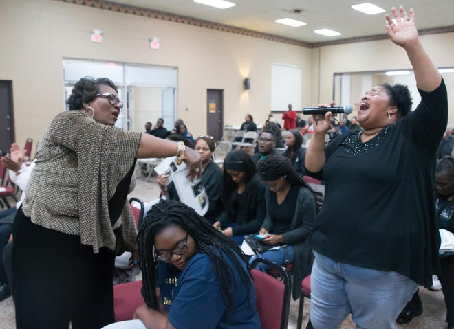 """Terrebonne NAACP Youth Director Diana Collins (left) fans Kina Alvis as she sings at the group's """"Salute to Greatness"""" program in honor of Martin Luther King Jr. at Dumas Auditorium in Houma in 2018. Collins is this year's main organizer for the Terrebonne NAACP Juneteenth celebration."""
