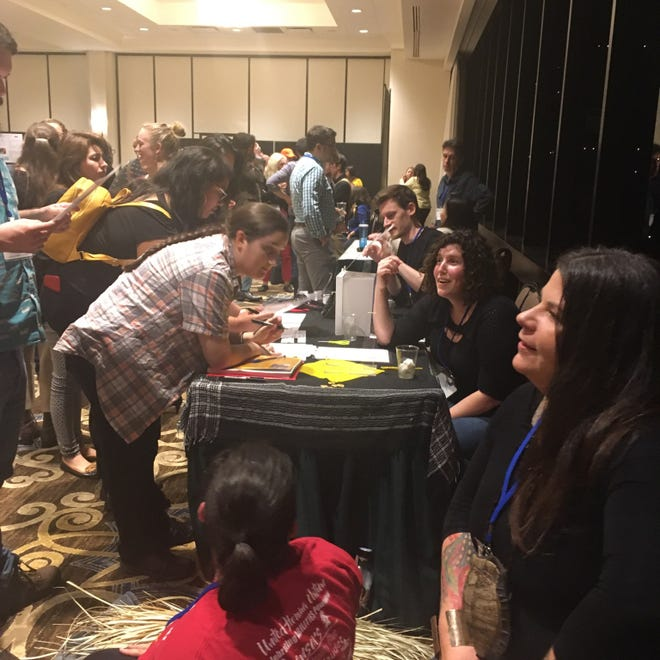 """The Houma Language Project tabling at the Linguistics Society Conference in New Orleans in 2019. Team member Rochelle Morgan-Verdin notes how previous generations were not able to receive the same education or other types of resources and support and this work """"is giving back in honor of those who sacrificed so much for us to be here today."""""""