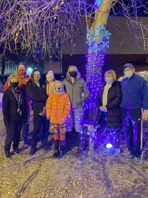 Rotary members at the Main Street Courtyard they lit up for the holidays