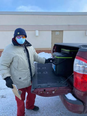 Rotary member Don Cavalier delivers Meals on Wheels