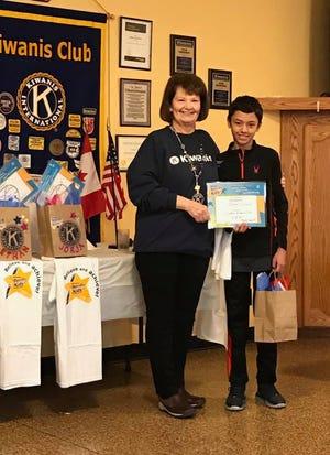 Kiwanis member Susan Sylvester presents a Terrific Kids program winner with a certificate