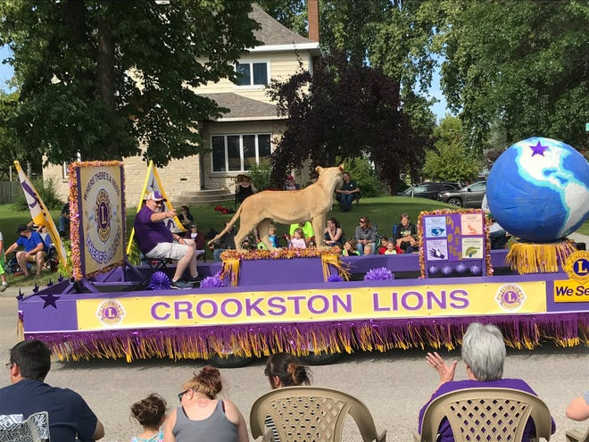 Lions member Steve Krueger on the Lions float at the Torchlight Parade