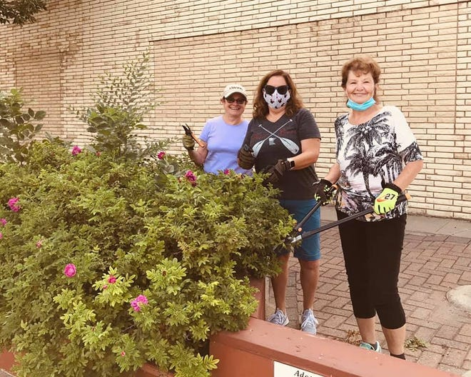 Kiwanis members Cindy Braseth, Shirley Iverson and Susan Sylvester tend to their adopted planter downtown