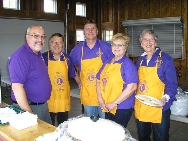 Lions members pose at their sponsored event Rib Fest over Ox Cart Days